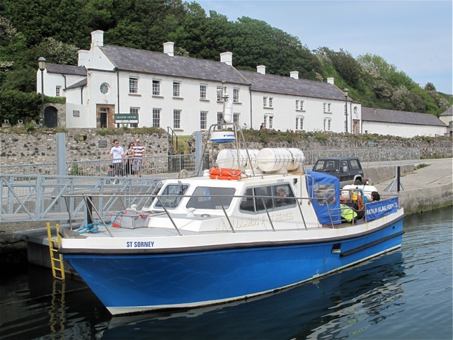 ferry-docked-on-rathlin-island-with-manor-house-an-inn-in-background-hilary-nangle-photo.jpg
